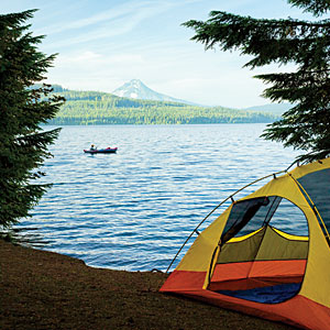 tent pitched next to lake