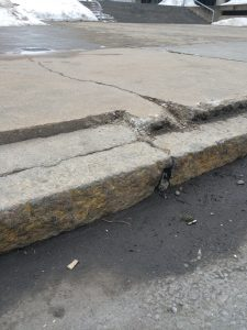 cracked curb 225x300 - Trip and Fall Attorney for Columbia, MD