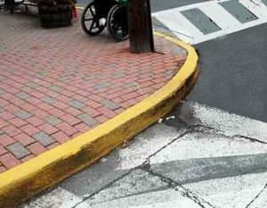 curb and sidewalk by road 300x233 - Slip, Trip and Fall Lawyer Serving Silver Spring, MD